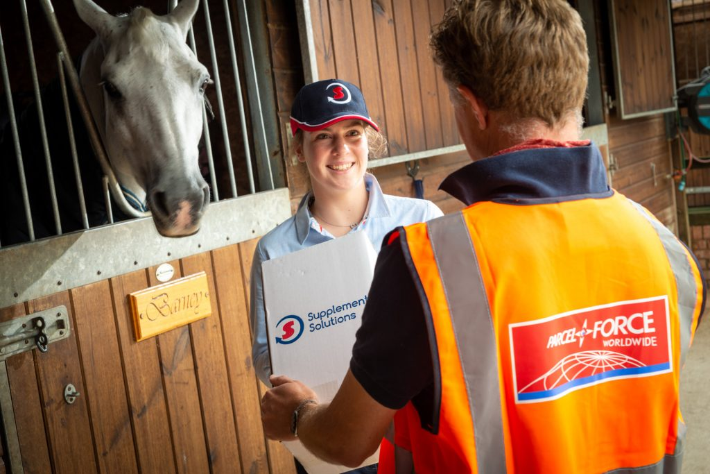 Customer and horse receiving their horse supplements delivery from Supplement Solutions